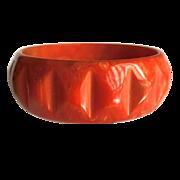 Bakelite Bangle Bracelet Carved and Marbled in Orange