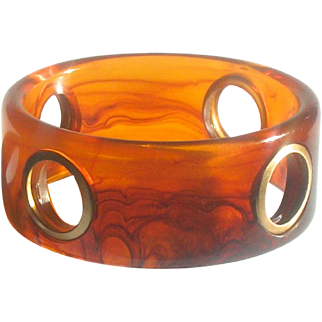 Bakelite Bangle Bracelet Carved with 4 Porthole Cut Outs