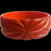 Bakelite  Bangle Bracelet Carved in Orange