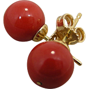 18K gold mounted 9 mm Natura Dark red Mediterranean Coral stud Earrings. 1980's