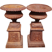Pair of Cast Iron Garden Urns on Stands