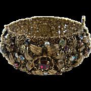 Elegant Rhinestone Bangle Bracelet with Raised Flowers and Scrolled Leaves
