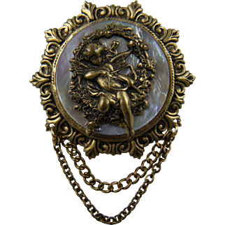 Putti Brooch on Abalone Background