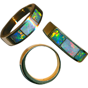 Ring--Fine Weighty 14 Karat Gold Band with Inlaid Firey Opal of Strong Color Play