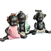 "Three Bisque Black Babies, 4"" each"