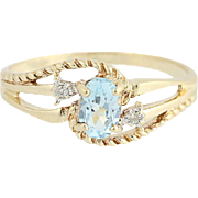 Blue Topaz & Diamond Bypass Ring - 10k Yellow Gold .59ctw