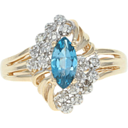 Blue Topaz & Diamond Bypass Ring - 10k Yellow Gold Women's .65ctw