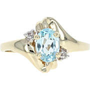 Blue Topaz & Diamond Accent Ring - 10k Yellow Gold 0.91ctw Bypass Oval