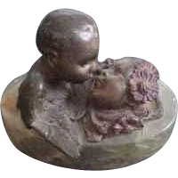 Small Bronze and Stone Sculpture of Cupid Kissing Woman