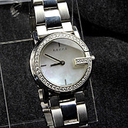 Swiss Ladies GUCCI Diamond Bezel, Mother of Pearl Dial, Stainless Steel Watch -- Model 101 L
