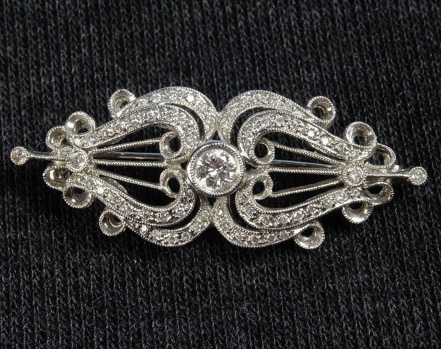 Ca: 1940's -- Hand Made 18K White Gold Filigree Brooch with 0.75 Ct. Total Weight of Diamonds