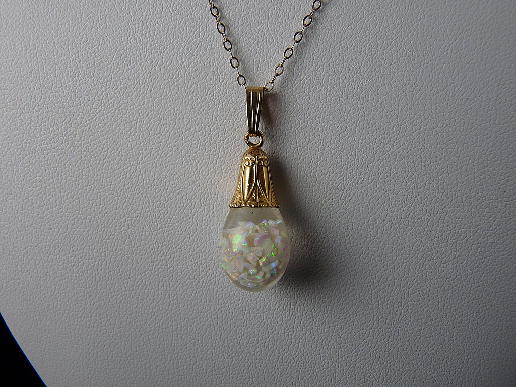 Horace H. Welch Floating Opal Pendant in 14K Gold Art Deco Mount