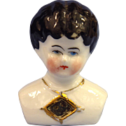 Tiny Low Brow China Head With Mirror Necklace