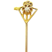 10 Karat gold shield stick pin with genuine natural diamond