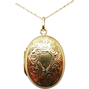 Oval Locket with 9 Karat Front and Back and 14 Karat Gold Chain