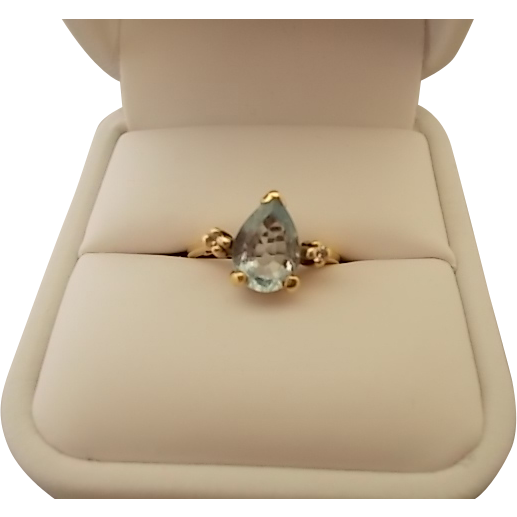 Elegant Pear Shaped Aqua Ring with Diamonds