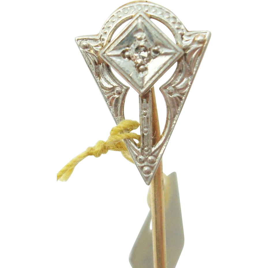 14 Karat gold stick pin with genuine natural diamond