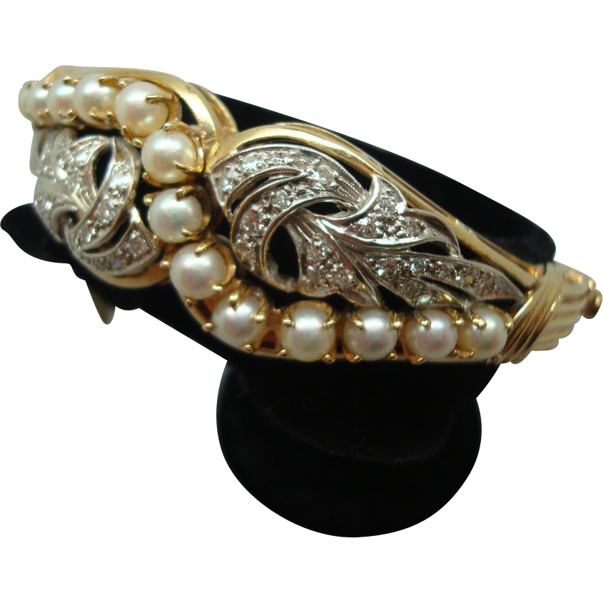 Beautiful 14 karat Gold Diamond and Pearl Bracelet