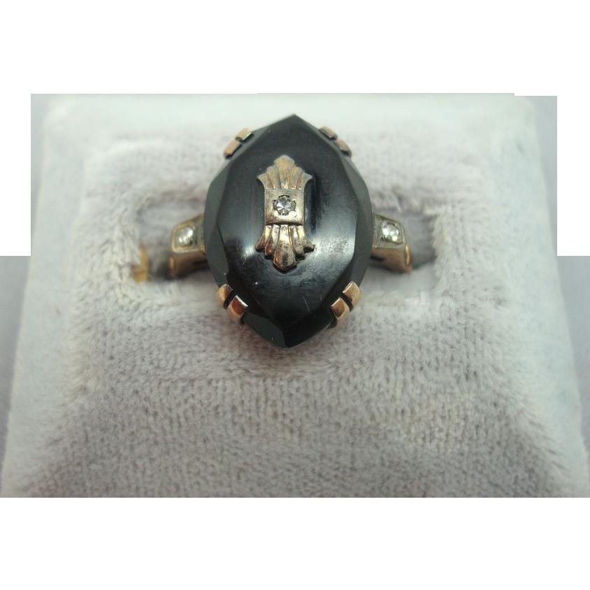 10 karat Oval Onyx Ring with Diamond
