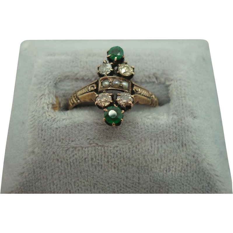 14 karat Ring with Diamonds, Pearls and Emeralds