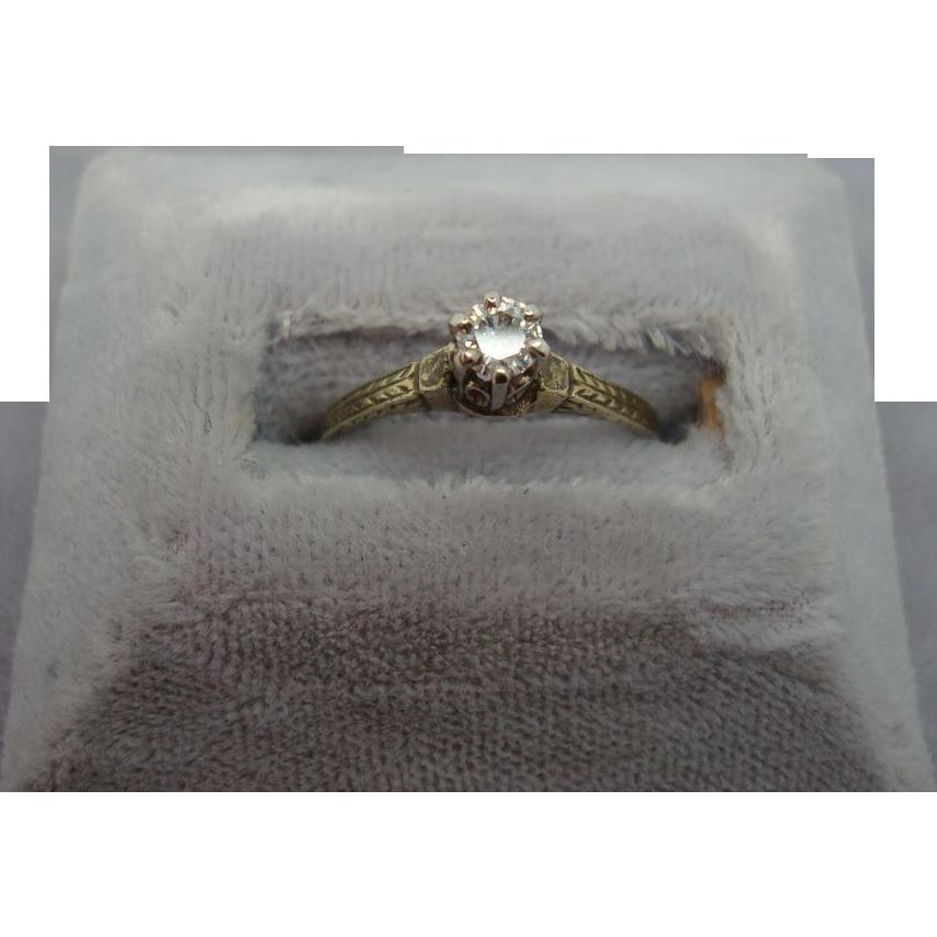 14 karat Ring with .15ct Diamonds