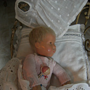 Oh my,.....what a darling Kathe Kruse doll tiny Du Mein, 25cm or 10 inch. with copper bed,