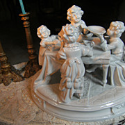 "Beautiful porcelain statue ""Children on the dinner table""."