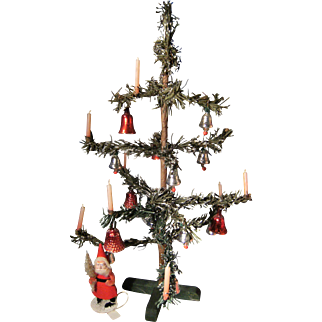Beautiful small antique Christmas tree with pink candles in....