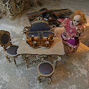A beautiful original French table, with a sofa, 2 chairs and a pouf.