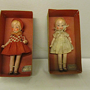 Beautiful doll sisters, antique bisque dolls , totally original dressed and boxed.