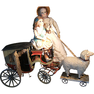 What is this? A beautiful antique carriage for your dolls.