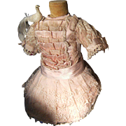 Beautiful pink dress antique doll  from 52cm or 20,5 Onches.