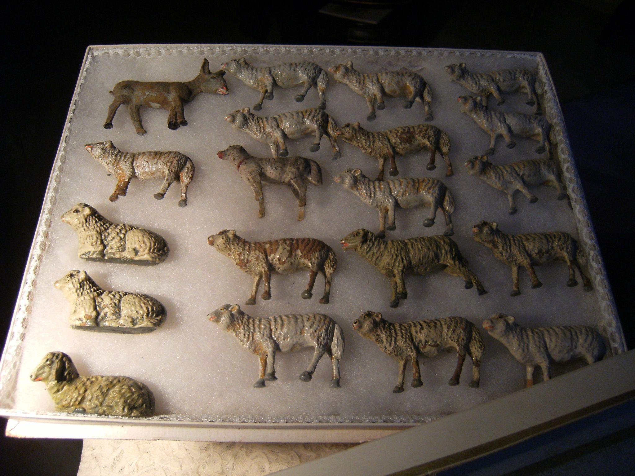 Nineteen  beautiful  antique sheep and 1 donkey in a beautiful box.