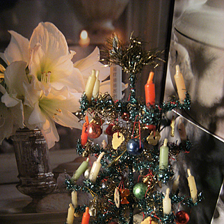 Beautiful amazing little German Christmas tree, full with balls and other decorations.