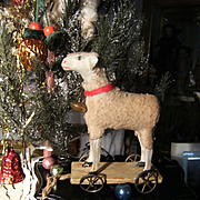 Beautiful  antique putz toy, a little lamb on wheels from Germany,  for in your doll's cabinet.