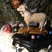 ON HOLD Antique lamb, German putz toy on plank with  tin wheels
