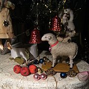 Antique lamb, German putz toy on plank with  tin wheels
