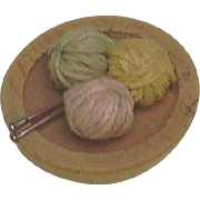 Tiniest, doll size wooden knitting bowl, with knitting needles and three balls of yarn