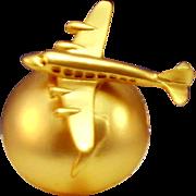 Midcentury style plane over globe brooch, costume