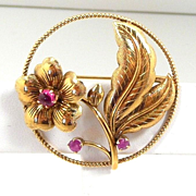 Snappy Retro Modern Ruby Circle Brooch set in 14KT. Gold