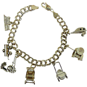 """On the Move"" Vintage 1950's Sterling Silver Charm Bracelet"