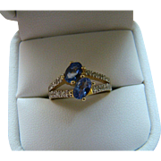 Diamond And Oval Tanzanite Bypass Ring - 10k Yellow Gold - Size 7