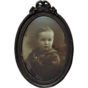 Antique Sepia Photograph Print of Boy in Military Uniform Victorian Oval Frame w/ Bubble Glass Ribbon Bow & Roses American