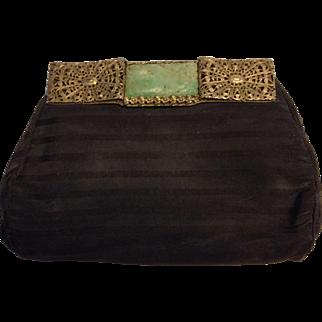 Black clutch with jade insert