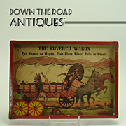 Lithographed Dexterity Game - Covered Wagon with Cowboy & Indian - 1920's