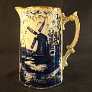Flow Blue Pitcher with Gold Tracery feat. Nautical Scene and Windmill