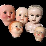 Five German doll heads, TLC