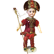 German Bisque American School boy in antique jester's outfit