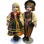 """Pair of  AM German Bisque dolls in Polish outfits, 14"""" tall"""