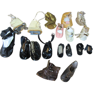 Large group of  single old doll shoes
